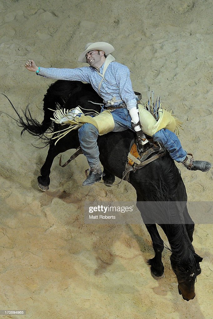 Ben Hall of Tumbarumba competes in the Bareback Bronc Riding during the National Rodeo Finals on June 15, 2013 on the Gold Coast, Australia.