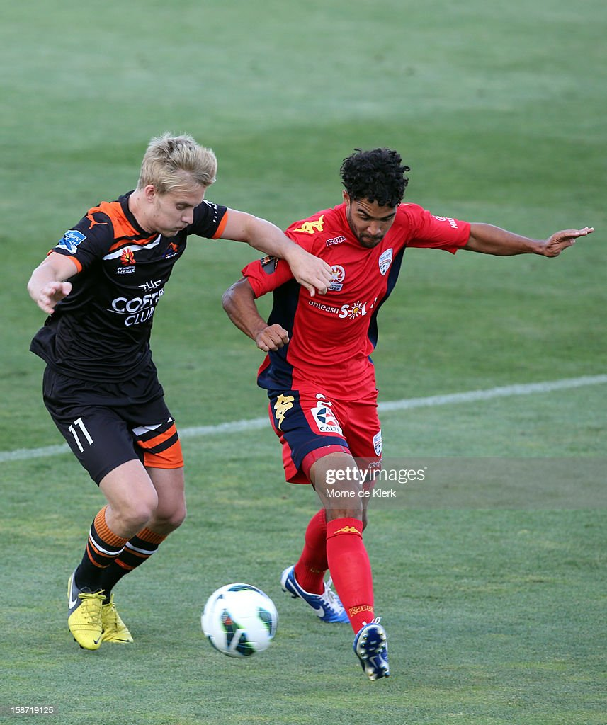 Ben Halloran of Brisbane competes with Osama Malik of Adelaide during the round 13 A-League match between Adelaide United and the Brisbane Roar at Hindmarsh Stadium on December 26, 2012 in Adelaide, Australia.