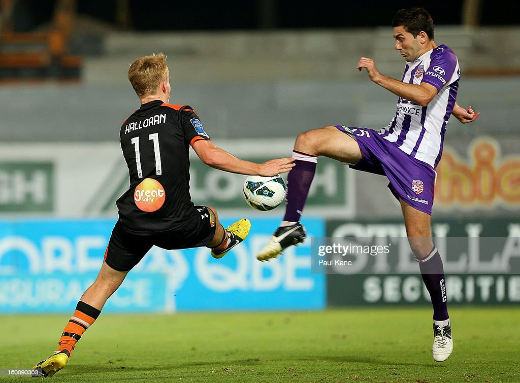 Ben Halloran (L) of the Roar and Steve Pantelidis of the Glory contest for the ball during the round 18 A-League match between the Perth Glory and the Brisbane Roar at nib Stadium on January 26, 2013 in Perth, Australia.
