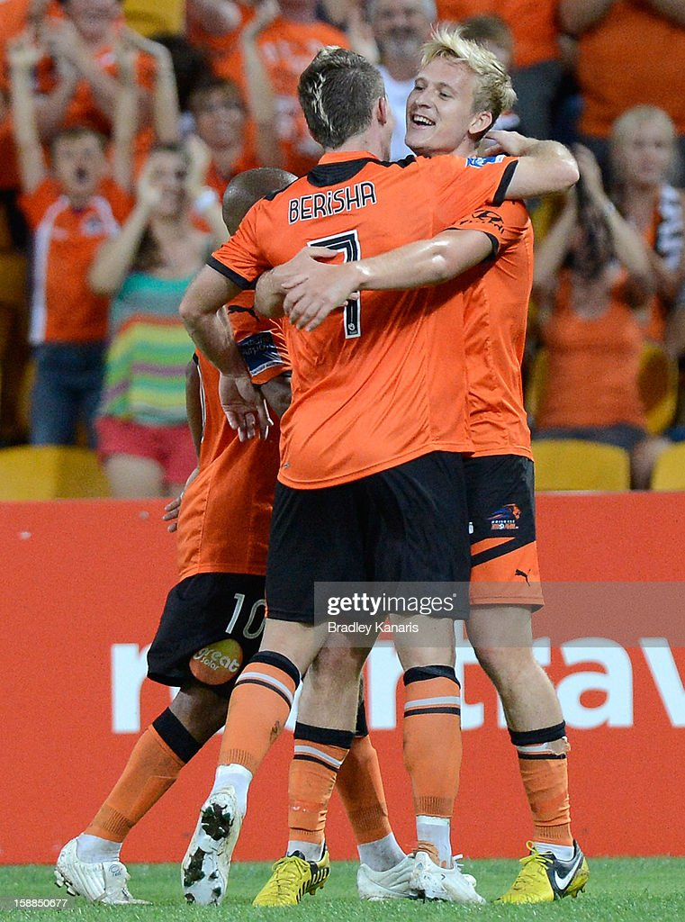 Ben Halloran of the Roar celebrates with team mate Besart Berisha after scoring a goal during the round 14 A-League match between the Brisbane Roar and the Wellington Phoenix at Suncorp Stadium on January 1, 2013 in Brisbane, Australia.