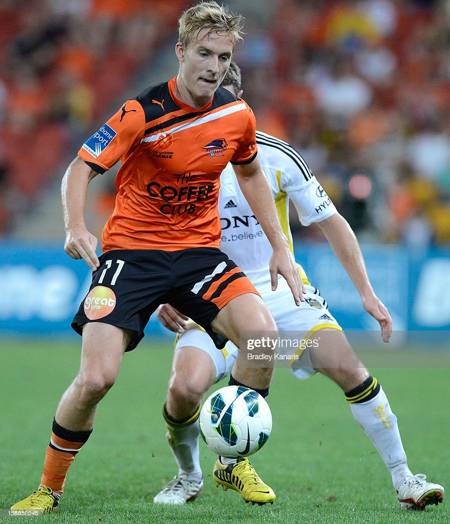 Ben Halloran of the Roar looks to take on the defence during the round 14 A-League match between the Brisbane Roar and the Wellington Phoenix at Suncorp Stadium on January 1, 2013 in Brisbane, Australia.