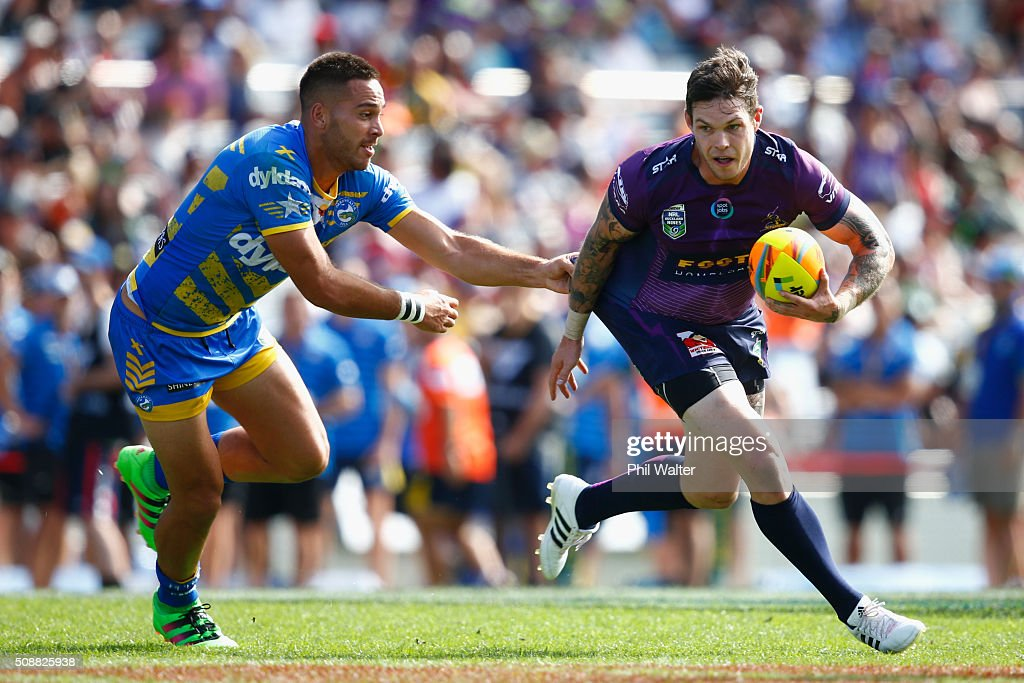 Ben Hampton of the Storm is tackled by Corey Norman of the Eels during the 2016 Auckland Nines semifinal match between the Storm and the Eels at Eden Park on February 7, 2016 in Auckland, New Zealand.