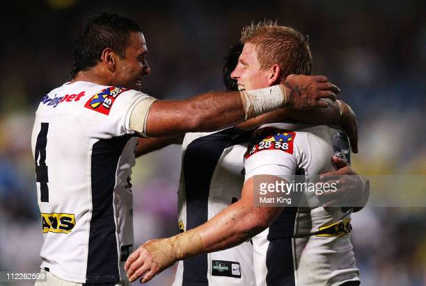 Ben Hannant of the Broncos celebrates with Justin Hodges after scoring a try during the round six NRL match between the Sydney Roosters and the...