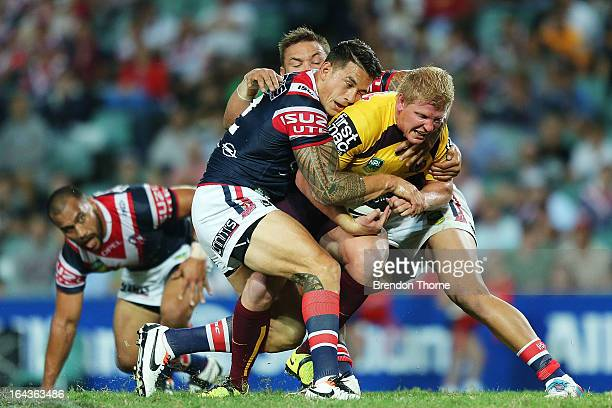 Ben Hannant of the Broncos is tackled by Sonny Bill Williams and Jared WaereaHargreaves of the Roosters during the round three NRL match between the...