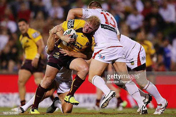 Ben Hannant of the Broncos is tackled by the Dragons defence during the round two NRL match between the St George Dragons and the Brisbane Broncos at...