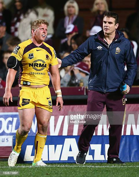 Ben Hannant of the Broncos receives attention from the trainer during the round 25 NRL match between the Manly Sea Eagles and the Brisbane Broncos at...
