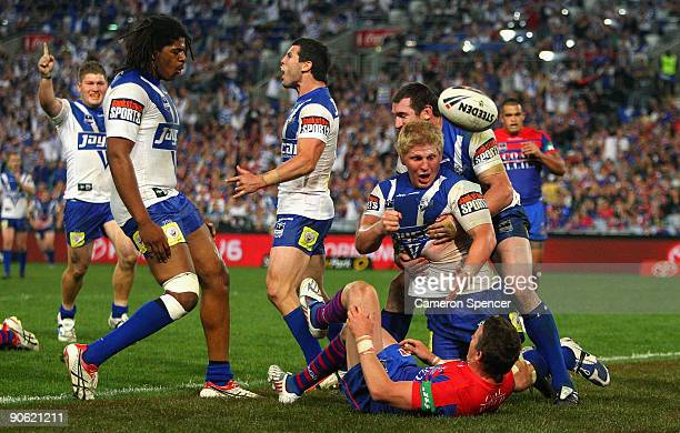 Ben Hannant of the Bulldogs celebrates scoring a try with team mates during the third NRL qualifying final match between the Bulldogs and the...