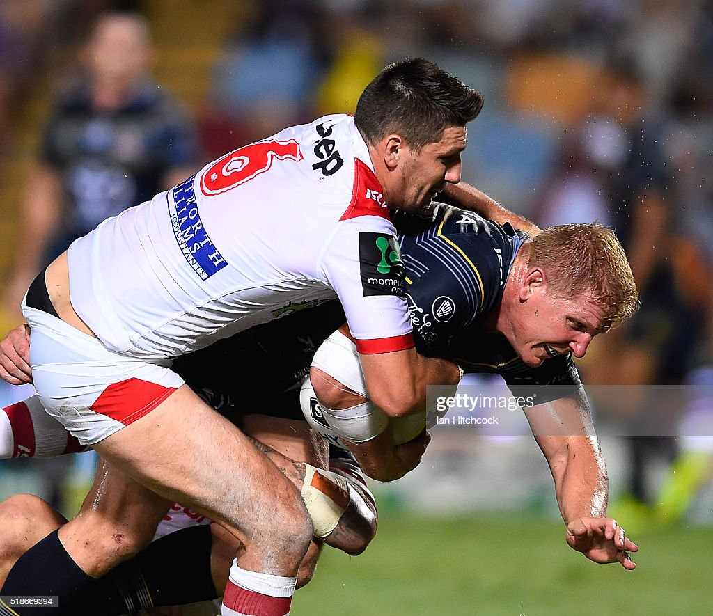 Ben Hannant of the Cowboys is tackled by Gareth Widdop of the Dragons during the round five NRL match between the North Queensland Cowboys and the St George Illawarra Dragons at 1300SMILES Stadium on April 2, 2016 in Townsville, Australia.