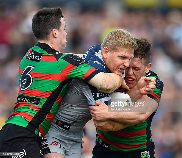 Ben Hannant of the Cowboys is tackled by Luke Keary and Cameron McInnes of the Rabbitohs during the round 17 NRL match between the South Sydney...