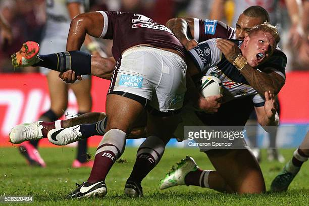 Ben Hannant of the Cowboys is tackled during the round nine NRL match between the Manly Sea Eagles and the North Queensland Cowboys at Brookvale Oval...