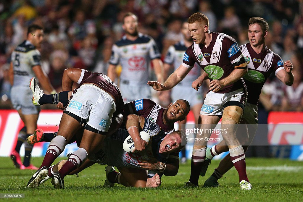 <a gi-track='captionPersonalityLinkClicked' href=/galleries/search?phrase=Ben+Hannant&family=editorial&specificpeople=596013 ng-click='$event.stopPropagation()'>Ben Hannant</a> of the Cowboys is tackled during the round nine NRL match between the Manly Sea Eagles and the North Queensland Cowboys at Brookvale Oval on April 30, 2016 in Sydney, Australia.