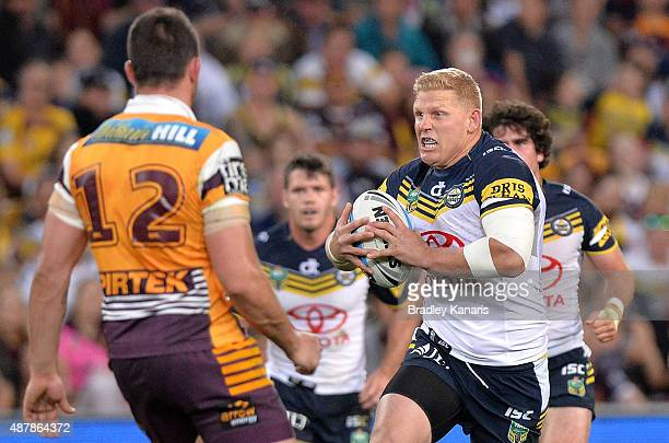 Ben Hannant of the Cowboys looks to take on the defence during the NRL Qualifying Final match between the Brisbane Broncos and the North Queensland...