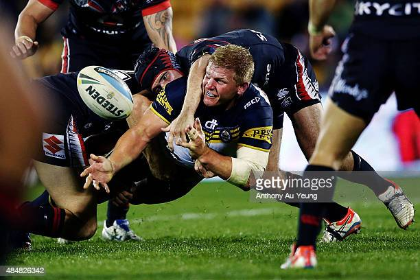Ben Hannant of the Cowboys offloads in a tackle during the round 24 NRL match between the New Zealand Warriors and the North Queensland Cowboys at Mt...