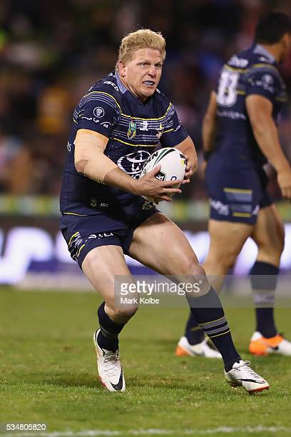 Ben Hannant of the Cowboys runs the ball during the round 12 NRL match between the St George Illawarra Dragons and the North Queensland Cowboys at...