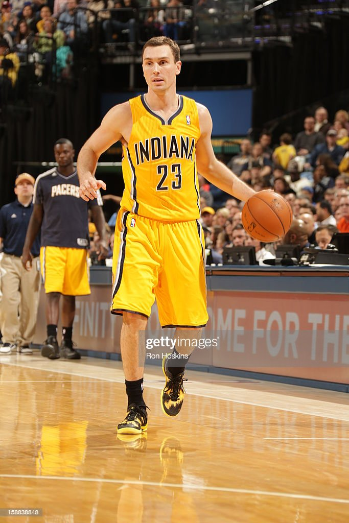 <a gi-track='captionPersonalityLinkClicked' href=/galleries/search?phrase=Ben+Hansbrough&family=editorial&specificpeople=4186465 ng-click='$event.stopPropagation()'>Ben Hansbrough</a> #23 of the Indiana Pacers brings the ball up court against the Memphis Grizzlies on December 31, 2012 at Bankers Life Fieldhouse in Indianapolis, Indiana.