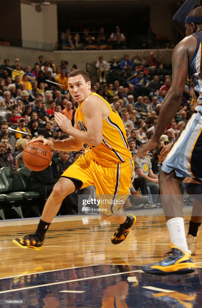 <a gi-track='captionPersonalityLinkClicked' href=/galleries/search?phrase=Ben+Hansbrough&family=editorial&specificpeople=4186465 ng-click='$event.stopPropagation()'>Ben Hansbrough</a> #23 of the Indiana Pacers drives to the basket against the Memphis Grizzlies on December 31, 2012 at Bankers Life Fieldhouse in Indianapolis, Indiana.
