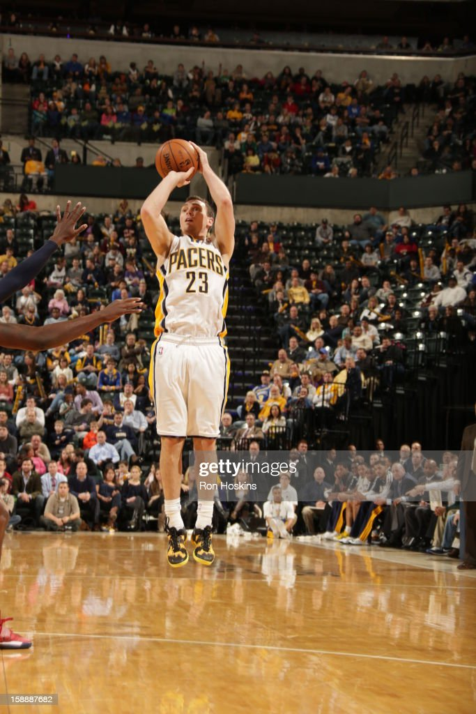 <a gi-track='captionPersonalityLinkClicked' href=/galleries/search?phrase=Ben+Hansbrough&family=editorial&specificpeople=4186465 ng-click='$event.stopPropagation()'>Ben Hansbrough</a> #23 of the Indiana Pacers shoots against the Washington Wizards on January 2, 2013 at Bankers Life Fieldhouse in Indianapolis, Indiana.
