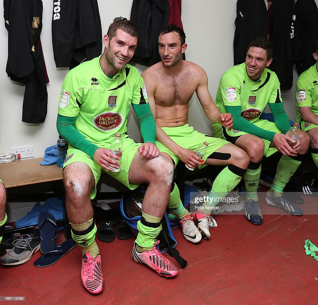 Ben Harding, Chris Hackett and Ben Tozer of Northampton Town celebrate in the changing room after the npower League Two Play Off Semi Final Second Leg between Cheltenham Town and Northampton Town at Abbey Business Stadium on May 5, 2013 in Cheltenham, England.