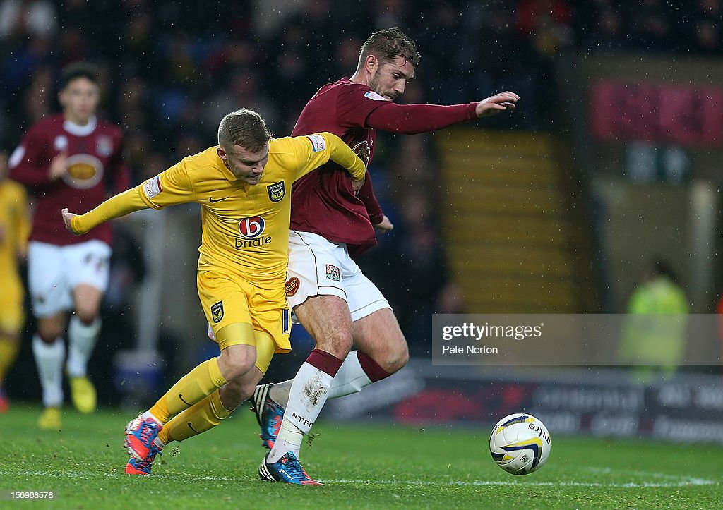 Ben Harding of Northampton Town challenges for the ball with Alfie Potter of Oxford United during the npower League Two match between Oxford United and Northampton Town at Kassam Stadium on November 24, 2012 in Oxford, England.