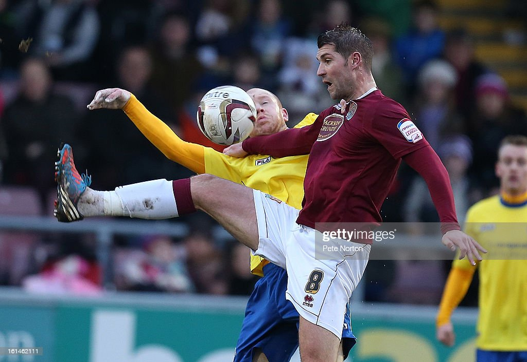Ben Harding of Northampton Town challenges for the ball with Jason Kennedy of Rochdale during the npower League Two match between Northampton Town and Rochdale at Sixfields Stadium on February 9, 2013 in Northampton, England.