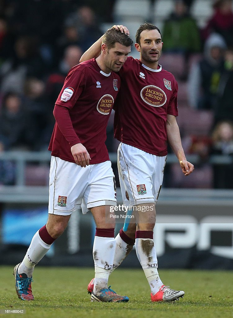 Ben Harding (L) of Northampton Town is congratulated by team-mate Chris Hackett after setting up his sides 2nd goal during the npower League Two match between Northampton Town and Rochdale at Sixfields Stadium on February 9, 2013 in Northampton, England.