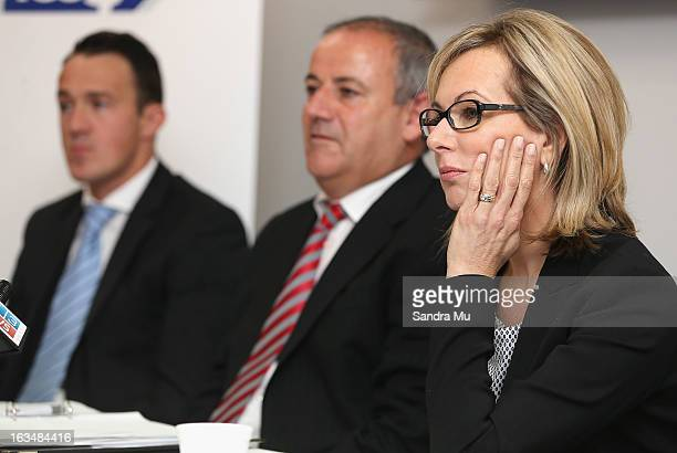 Ben Hardwick of Slater and Gordon New Zealand lawyer Andrew Hooker and Michelle Silvers of the Litigation Lending Services speak to media during a...