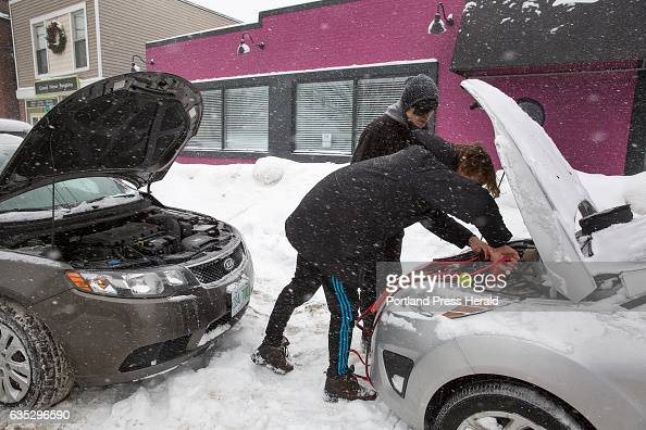 Ben Harnisch a USM student front jumpstarts his car with the help of his friend Derrick Nelson a student at the Maine College of Art on Portland...