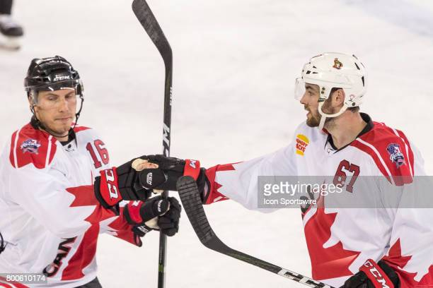 Ben Harpur of Team Canada and Chad Nehring of Team Canada celebrate a Team Canada Goal during the Melbourne Game of the Ice Hockey Classic on June 24...