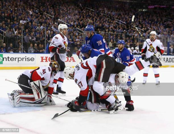 Ben Harpur of the Ottawa Senators tumbles over Cody in Game Three of the Eastern Conference Second Round during the 2017 NHL Stanley Cup Playoffs at...