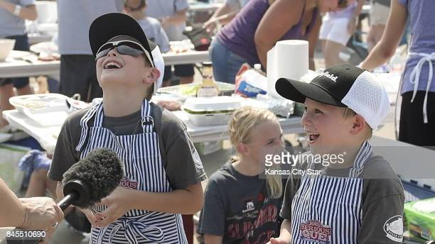 Ben Henricks left and his younger brother Graeme Henricks both of Fenton Mo laugh at a question about where hamburgers come from during the Kids Que...
