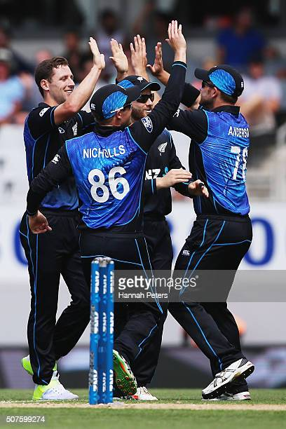 Ben Henry of the Black Caps celebrates the wicket of Azhar Ali of Pakistan with Corey Anderson of the Black Caps and Kane Williamson of the Black...