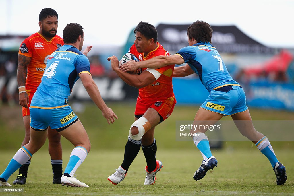Ben Henry of the Warriors is tackled during the NRL Trial Match between the New Zealand Warriors and the Gold Coast Titans at Toll Stadium on February 13, 2016 in Whangarei, New Zealand.