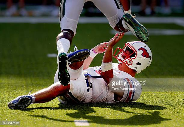 Ben Hicks of the Southern Methodist Mustangs gets knocked down against the Baylor Bears in the seconf half at McLane Stadium on September 10 2016 in...