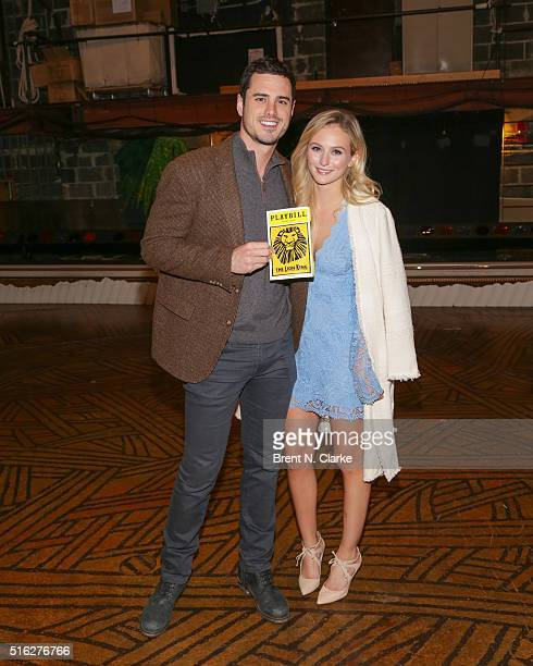 Ben Higgins and Lauren Bushnell from 'The Bachelor' pose for photographs after attending 'The Lion King' on Broadway at the Minskoff Theatre on March...