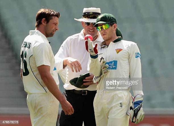 Ben Hilfenhaus and Tim Paine of the Tigers speak with the umpire during day two of the Sheffield Shield match between Victoria and Tasmania at...