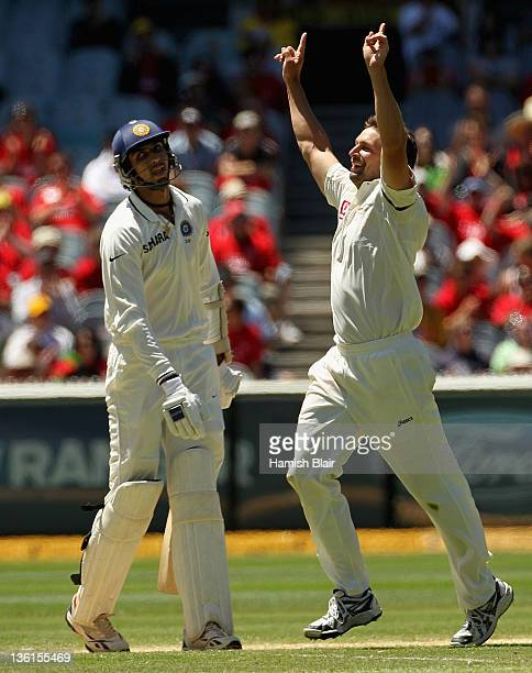 Ben Hilfenhaus of Australia celebrates after taking the wicket of Ishant Sharma of India during day three of the First Test match between Australia...