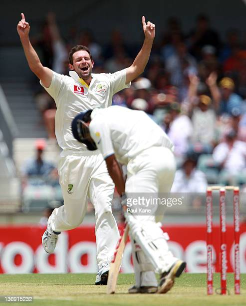Ben Hilfenhaus of Australia celebrates dismissing Gautam Gambhir of India during day one of the third Test match between Australia and India at WACA...