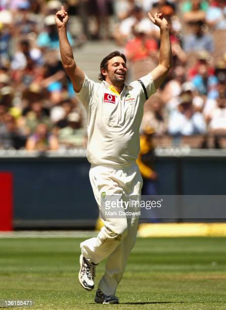 Ben Hilfenhaus of Australia celebrates taking the wicket of Ishant Sharma of India during day three of the First Test match between Australia and...