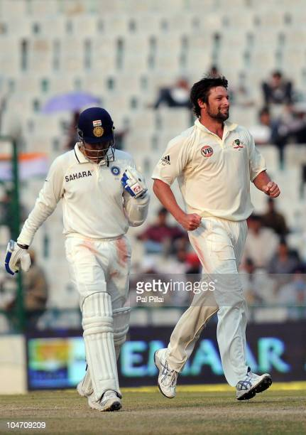 Ben Hilfenhaus of Australia celebrates the wicket of Virender Sehwag of India during day four of the First Test match between India and Australia at...