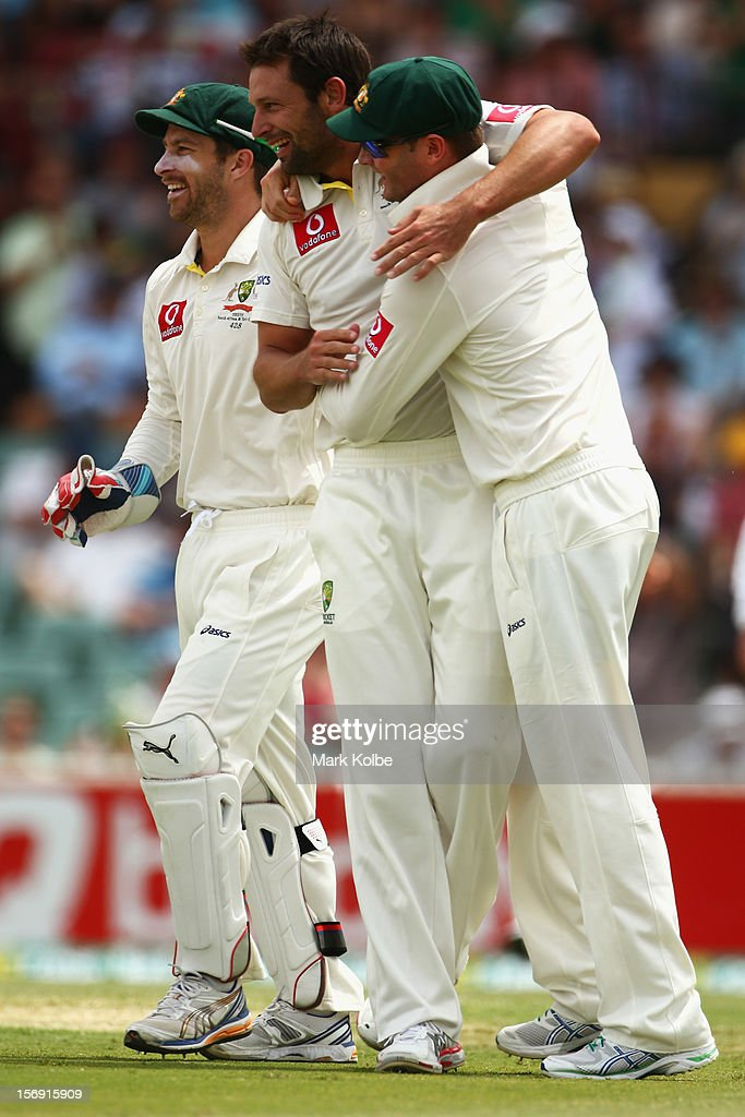 Ben Hilfenhaus of Australia celebrates with Michael Clarke of Australia after taking the wicket of Graeme Smith of South Africa during day four of the Second Test Match between Australia and South Africa at Adelaide Oval on November 25, 2012 in Adelaide, Australia.