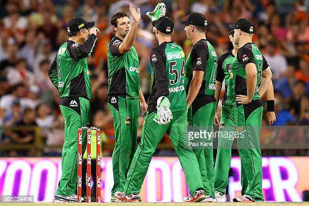 Ben Hilfenhaus of the Stars celebrates with team mates after dismissing Jhye Richardson of the Scorchers during the Big Bash League match between the...