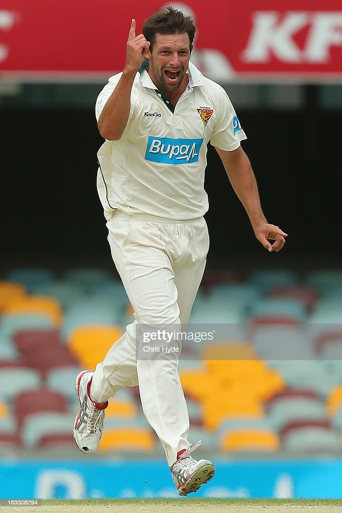 Ben Hilfenhaus of the Tigers celebrates after dismissing Dom Michael of the Bulls during day two of the Sheffield Shield match between the Queensland Bulls and the Tasmanian Tigers at The Gabba on March 8, 2013 in Brisbane, Australia.