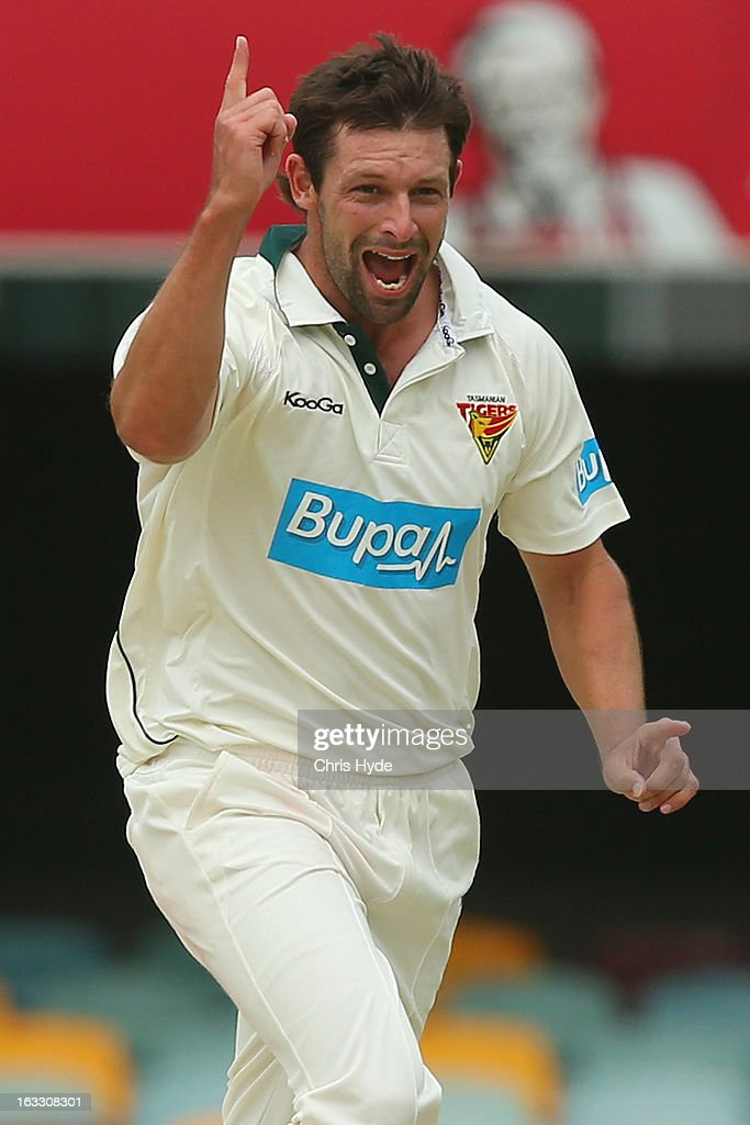 Ben Hilfenhaus of the Tigers celebrates after dismissing Dom Michael of the Bulls for a duck during day two of the Sheffield Shield match between the Queensland Bulls and the Tasmanian Tigers at The Gabba on March 8, 2013 in Brisbane, Australia.