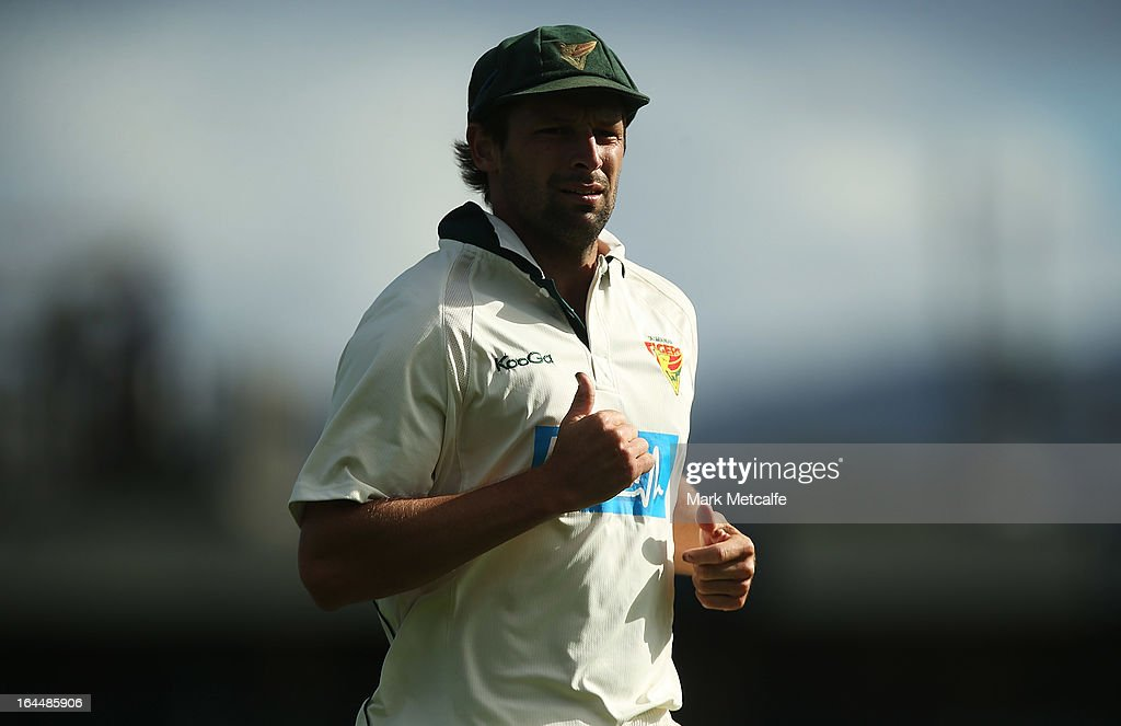 Ben Hilfenhaus of the Tigers fields during day three of the Sheffield Shield final between the Tasmania Tigers and the Queensland Bulls at Blundstone Arena on March 24, 2013 in Hobart, Australia.