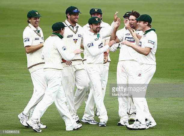 Ben Hilfenhaus of the Tigers is congratulated by his team mates after taking the wicket of Steve O'Keefe of the the Blues during day two of the...