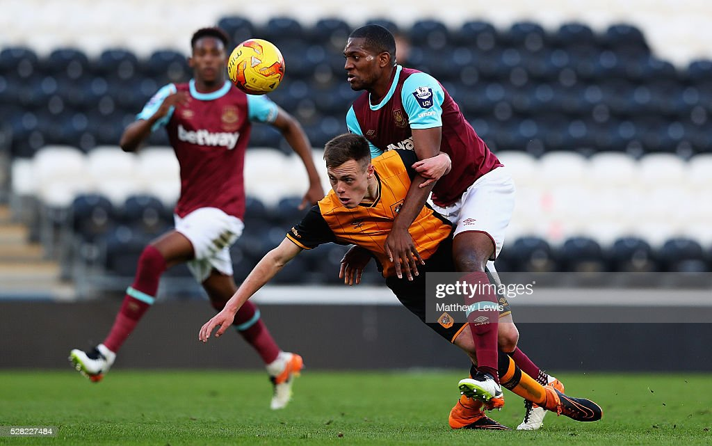Ben Hinchliffe of Hull City and Doneil Henry of West Ham challenge for the ball during the Second Leg of the Premier League U21 Cup Final at the KC Stadium on May 04, 2016 in Hull, England.