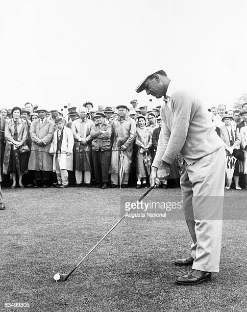 Ben Hogan addresses the ball in front of a large gallery during the 1953 Masters Tournament at Augusta National Golf Club in April 1953 in Augusta...