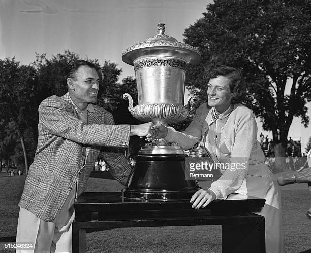 Ben Hogan left and Babe Zaharias exchange congratulations at Tam O'Shanter Country Club where they each won World Championship of Golf titles today...
