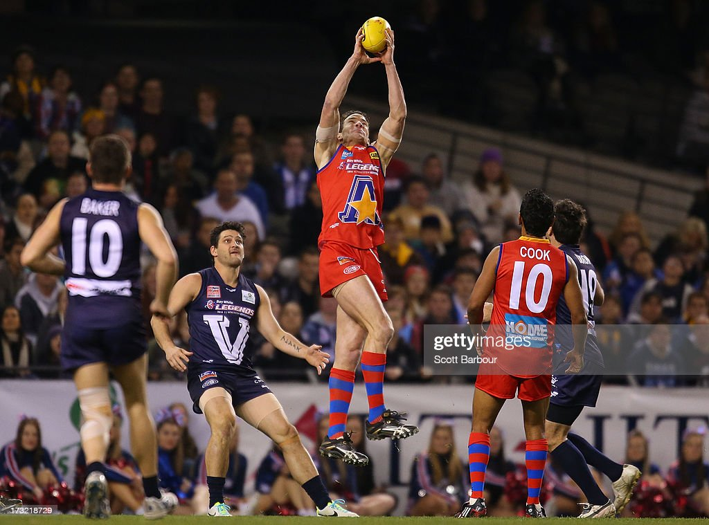 <a gi-track='captionPersonalityLinkClicked' href=/galleries/search?phrase=Ben+Holland&family=editorial&specificpeople=212824 ng-click='$event.stopPropagation()'>Ben Holland</a> of the All Stars takes a mark during the EJ Whitten Legends AFL game between Victoria and the All Stars at Etihad Stadium on July 10, 2013 in Melbourne, Australia.