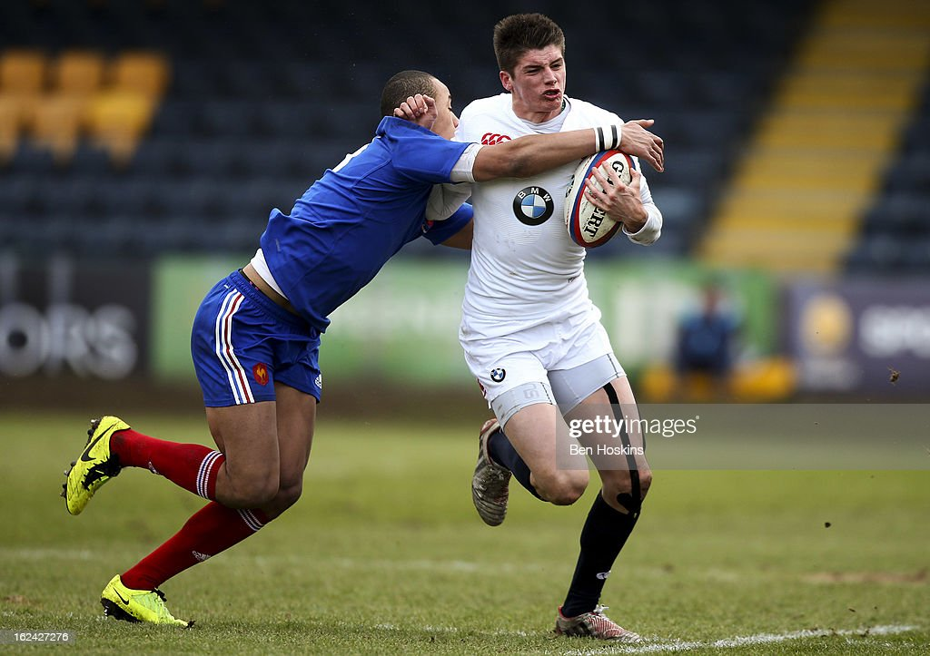 Ben Howard of England hands off the tackle of Gael Fickou of France during the U20s RBS Six Nations match between England U20 and France U20 at the Sixways Stadium on February 23, 2013 in Worcester, England.